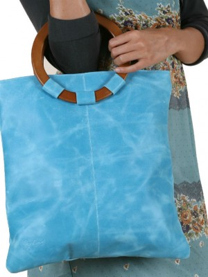Pale Blue leather bag on model shown in closeup