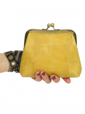 Yellow Sigal Levi clutch purse in hand